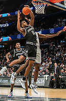 WASHINGTON, DC - FEBRUARY 19: Alpha Diallo #11 of Providence shoots over Timothy Ighoefe #5 of Georgetown during a game between Providence and Georgetown at Capital One Arena on February 19, 2020 in Washington, DC.