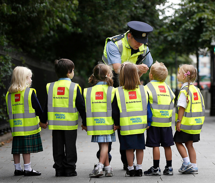 RSA High Visibility Vest Distribution Launch..Garda Niall Cunningham pictured with school children at the launch of the Road Safety Authority 85,500 high visibility vest distribution.