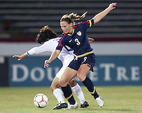 Christie Rampone (3) of USA tackles Kwon Han Nul (8) of South Korea during an international friendly match at City Stadium on November 1, 2008 in Richmond, Virginia. USA won 3-1. Photo by Tony Quinn / isiphotos.com