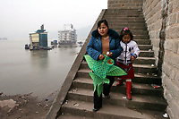CHINA. Sichuan Province. Chongqing. A woman and her child near the Yangtze river which is at its lowest level in 150 years as a result of a nationwide drought. Chongqing is a city of over 3,000,000 people, famed for being the capital of China between 1938 and 1946 during World War II. It is situated on the banks of the Yangtze river, China's longest river and the third longest in the world. Originating in Tibet, the river flows for 3,964 miles (6,380km) through central China into the East China Sea at Shanghai.  2008