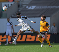Wolverhampton Wanderers' Ruben Neves (right) battles with Fulham's Ola Aina (left) <br /> <br /> Photographer David Horton/CameraSport<br /> <br /> The Premier League - Wolverhampton Wanderers v Fulham - Sunday 4th October 2020 - Molineux Stadium - Wolverhampton<br /> <br /> World Copyright © 2020 CameraSport. All rights reserved. 43 Linden Ave. Countesthorpe. Leicester. England. LE8 5PG - Tel: +44 (0) 116 277 4147 - admin@camerasport.com - www.camerasport.com