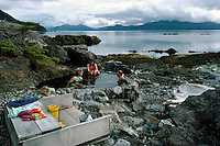 Queen Charlotte Islands (Haida Gwaii), Northern BC, British Columbia, Canada - People soaking in Hot Spring Pool on Hotspring Island, Gwaii Haanas National Park Reserve and Haida Heritage Site