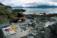Queen Charlotte Islands (Haida Gwaii), Northern BC, British Columbia, Canada - People soaking in Hot Spring Pool on Hotspring Island, Gwaii Haanas National Park Reserve and Haida Heritage Site
