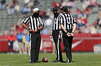 Officials talk, Saturday, October 17, 2020 during the first quarter of a football game at Donald W. Reynolds Razorback Stadium in Fayetteville. Check out nwaonline.com/201018Daily/ for today's photo gallery. <br /> (NWA Democrat-Gazette/Charlie Kaijo)