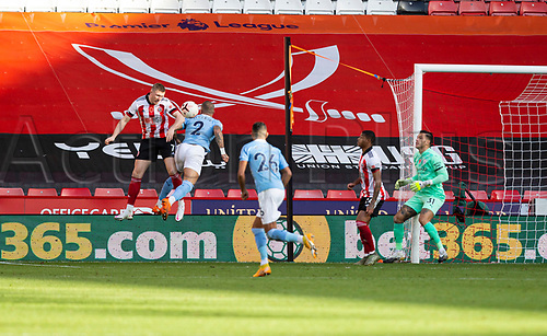31st October 2020; Bramall Lane, Sheffield, Yorkshire, England; English Premier League Football, Sheffield United versus Manchester City; John Lundstram of Sheffield United and Kyle Walker of Manchester City jump to head the ball in the Manchester City goal area