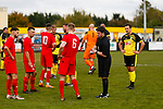 Tempers flare as Grant 'Rhino' Ryan of Hucknall Town suffers a cut to the back of the head after a challenge from Jake Carlisle. Carlisle receives a yellow card.  Hucknall Town v Heanor Town, 17th October 2020, at the Watnall Road Ground, East Midlands Counties League. Photo by Paul Thompson.