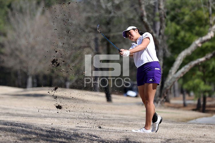 WALLACE, NC - MARCH 09: Tonrak Tasaso of High Point University hits from the fairway on the 15th hole of the River Course at River Landing Country Club on March 09, 2020 in Wallace, North Carolina.