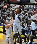 13 December 2008: Tim Ambrose of Albany rips a rebound during a game between Canisius and Albany won by Albany 74-46 at SEFCU Arena in Albany, New York.