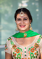 Indian Woman Wearing Green & Orange Traditional Clothing, Renton Multicultural Festival 2017, WA, USA.