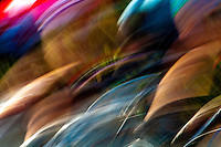 Abstract photograph of the colourful lines produced by the speed of a cyclist racing to the finish line.