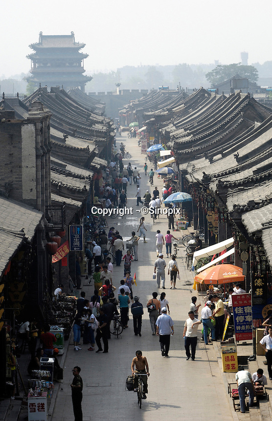 A street with chinese traditional architectures in Pingyao Ancient City in  Shanxi, China. Being one of the four wholly-protected ancient cities in China, Pingyao Ancient City is thought of as the 'treasure house' of ancient Chinese architectures..05 Jun 2007.