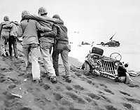 They did their part.  Wounded Marines are helped to an aid station by Navy corpsmen and Marine walking wounded.  Iwo Jima, ca.  February/March 1945. Cpl. Eugene Jones. (Marine Corps)<br /> Exact Date Shot Unknown<br /> NARA FILE #:  127-G-110244<br /> WAR & CONFLICT #:  908