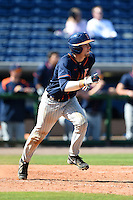 Cal State Fullerton Titans catcher A.J. Kennedy (10) runs to first during a game against the Louisville Cardinals on February 15, 2015 at Bright House Field in Clearwater, Florida.  Cal State Fullerton defeated Louisville 8-6.  (Mike Janes/Four Seam Images)