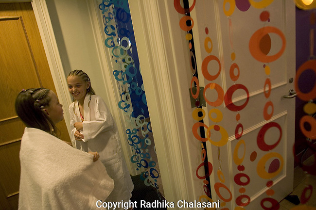 SAN ANTONIO, TEXAS-MARCH 25: Sydney (L), 7, and her cousin Madison,10, wait outside the massage and facial rooms at Spaaht, the spa for those 17 and younger, at the Hyatt Regency Hill Country Resort March 25, 2005 in San Antonio. Since it's opening two years ago, Spaaht has been a popular place for teens and pre-teens on  vacation at the resort with their families. ©Radhika Chalasnai