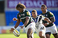 Marland Yarde of London Irish clears the ball as he is challenged by Kyle Eastmond of Bath Rugby during the Aviva Premiership match between London Irish and Bath Rugby at the Madejski Stadium on Saturday 22nd September 2012 (Photo by Rob Munro)