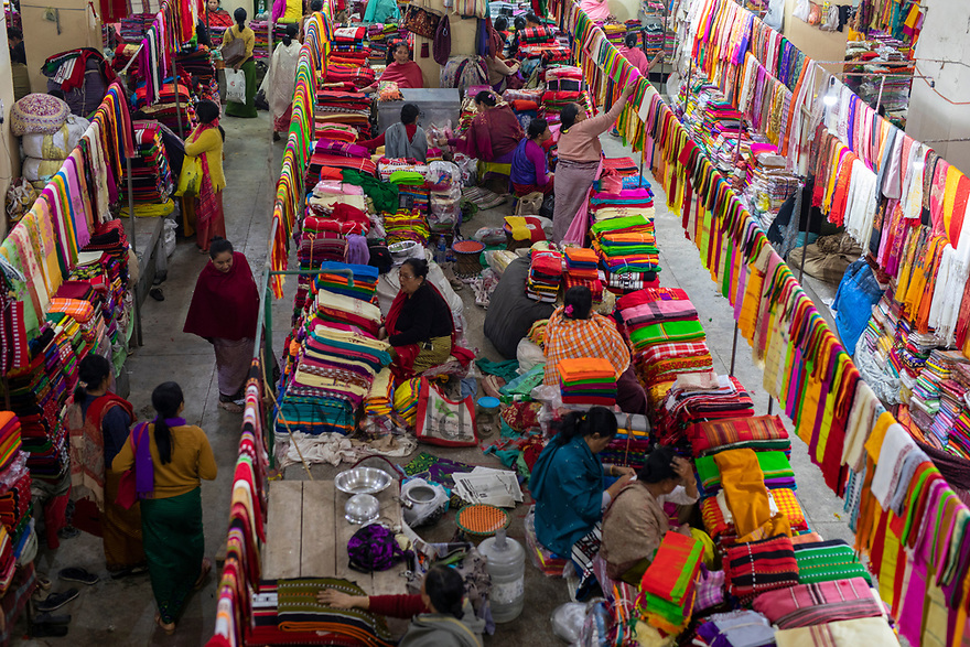 India - Manipur - Imphal - One of the three pagodas of the Ima Market is exclusively reserved to the textiles. Here both local and Indian textiles are sold at affordable prices.