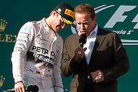 March 15, 2015: Arnold Schwarzenegger congratulates Nico Rosberg (DEU) #6 (2nd) on the podium at the 2015 Australian Formula One Grand Prix at Albert Park, Melbourne, Australia. Photo Sydney Low