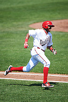 Auburn Doubledays third baseman Kelvin Gutierrez (36) runs to first base during a game against the Vermont Lake Monsters on July 13, 2016 at Falcon Park in Auburn, New York.  Auburn defeated Vermont 8-4.  (Mike Janes/Four Seam Images)