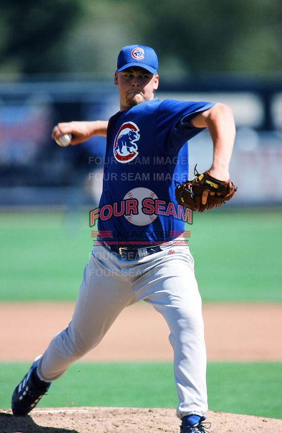 Kerry Wood of the Chicago Cubs pitches during a 1999 Major League Baseball Spring Training game Phoenix, Arizona. (Larry Goren/Four Seam Images)