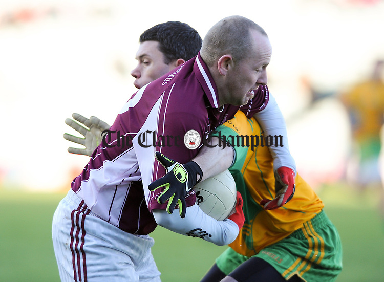 Pat Nagle of St Breckan's in action against John Sheehan of Gneeveguilla during the Intermediate Club Munster final at The Gaelic Grounds. Photograph by John Kelly.