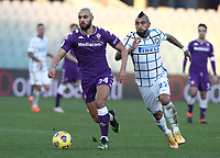 Football Soccer: Tim Cup Round of 16 Fiorentina - FC Internazionale Milano, Artemio Franchi  stadium, Florence, January 13, 2021. <br /> Fiorentina's Sofyan Amrabat (l) in action with Inter's Arturo Vidal (r) during the Italian Tim Cup football match between Fiorentina and Inter at Florence's Artemio Franchi stadium, on January 13, 2021.  <br /> UPDATE IMAGES PRESS/Isabella Bonotto