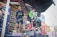 champaign battle on the finish podium between race winner Rigoberto Uran (COL/Cannondale-Drapac) & runner-up Adam Yates (GBR/Orica-Scott) & 3rd finisher Fabio Aru (ITA/Astana)<br /> <br /> 98th Milano - Torino 2017 (ITA) 186km