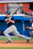 Tobias Streich #13 of the Elizabethton Twins follows through on his swing versus the Burlington Royals at Burlington Athletic Park July 19, 2009 in Burlington, North Carolina. (Photo by Brian Westerholt / Four Seam Images)