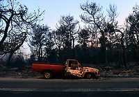 Pictured: A burned out pick up truck.<br />