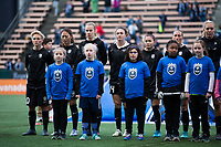 Seattle, WA - Saturday March 24, 2018: Seattle Reign FC, escort kids during a regular season National Women's Soccer League (NWSL) match between the Seattle Reign FC and the Washington Spirit at the UW Medicine Pitch at Memorial Stadium.