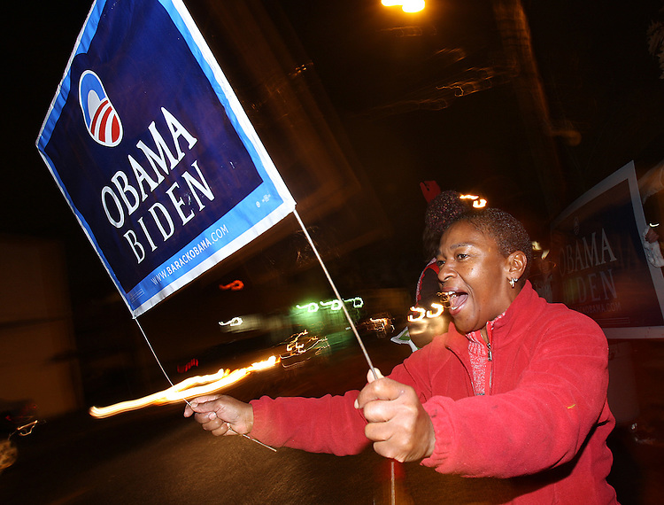 Contessa Jenkins of Portland waves her Obama Biden sign to motorists honking their horns to celebrate Barack Obama being elected as President of the United States.