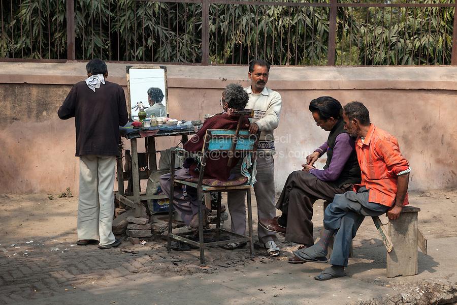 Agra, India.  Barbershop on the Sidewalk.