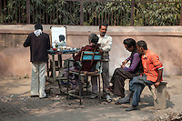 Agra, India.  Barbershop on the Sidewalk.