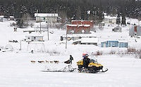Ramey Smyth passes a trail breaker pulling a trail groomer as he arrives at the White Mountain checkpoint on tuesday afternoon.