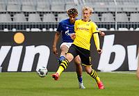 16th May 2020, Signal Iduna Park, Dortmund, Germany; Bundesliga football, Borussia Dortmund versus FC Schalke; Dortmunds Julian Brandt plays the ball away from Jean-Clair Todibo of FC Schalke