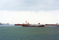 Singapore:  Ships in roadsted, a place outside the harbor where ships can anchor.  Photo '82.