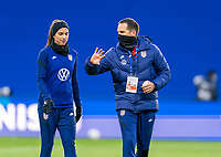 LE HAVRE, FRANCE - APRIL 13: Alex Morgan #13 of the USWNT talks with Milan Ivanovic before a game between France and USWNT at Stade Oceane on April 13, 2021 in Le Havre, France.