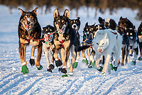 Scott Smith and team run down the trail near sunset after leaving the Kaltag checkpoint on Saturday March 12th during the 2016 Iditarod.  Alaska    <br /> <br /> Photo by Jeff Schultz (C) 2016  ALL RIGHTS RESERVED