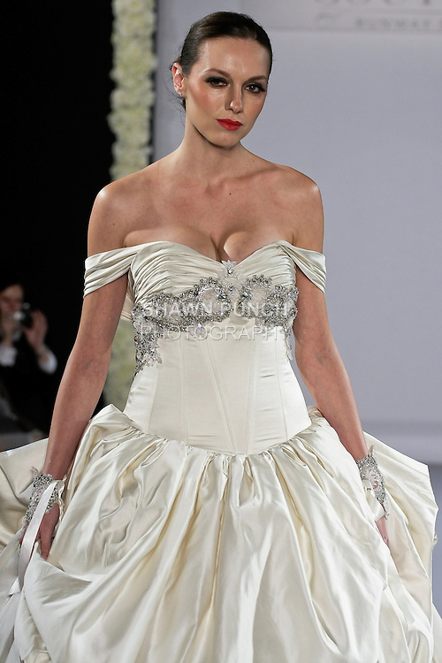 Model walks runway in a Yara bridal gown from the Katerina Bocci 2013 collection, at the Couture Runway Show, during New York Bridal Fashion Week at The Hilton Hotel, October 13, 2012.
