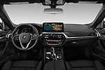 Stock photo of straight dashboard view of 2021 BMW 5-Series 530e-Sport 4 Door Sedan Dashboard