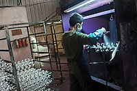 Christmas baubles are made at Yiwu Festival Gifts Co Ltd in Yi Wu, China. The factory makes Christmas trees for UK retail giant B & Q. Yi Wu exports 40-50 % of the entire European Christmas decorations and 70 % of US and Mexico's Christmas gifts come from Yi Wu.