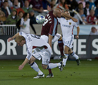 Real Salt Lake's Nat Borchers (6, white) upends Colorado's Conor Casey. Real Salt Lake earned a tied versus the Colorado Rapids securing a place in the postseason. Dick's Sporting Goods Park, Denver, Colorado, October, 25, 2008. Photo by Trent Davol/isiphotos.com