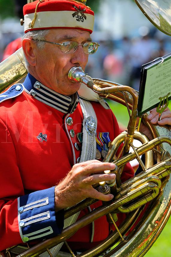 "Sousaphone player of the Second Company, Governor's Foot Guard Band, New Haven, Connecticut, performs on Norwichtown Green in celebration of Samuel Huntington's birthday. Arguably the first president of the USA,  Huntington was president of Congress when the nation was first designated ""United States"" in the Articles of Confederation."