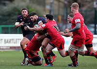 Ben Mosses of London Scottish is tackled during the Greene King IPA Championship match between London Scottish Football Club and Jersey at Richmond Athletic Ground, Richmond, United Kingdom on 16 December 2017. Photo by Mark Kerton / PRiME Media Images.