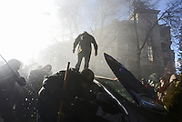 The protesters vandalize a parked car in Maidan square. Kiev, Ukraine