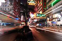 Tarffic speeds at night along Nathan road in Tsim Sha Tsui, Hong Kong. Nathan Road is the main thoroughfare in Kowloon, Hong Kong that goes in a south-north direction from Tsim Sha Tsui to Mong Kok.<br /> 30 Oct 2007