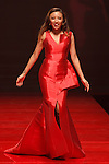 TV personality Jeannie Mai walks runway in a red dress by John Paul Ataker New York, for the Red Dress Collection 2017 fashion show, for The American Heart Association, presented by Macy's at the Hammerstein Ballroom in New York City on February 9, 2017; during New York Fashion Week Fall 2017.