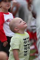 Batavia Muckdogs young fan looks up to the players while getting autographs from the players during the teams pre-season pep rally at Dwyer Stadium on June 15, 2011 in Batavia, New York.  Photo By Mike Janes/Four Seam Images