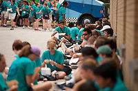 """Members eat lunch during """"Circle the City with Service,"""" the Kiwanis Circle K International's 2015 Large Scale Service Project, on Wednesday, June 24, 2015, in Indianapolis. (Photo by James Brosher)"""