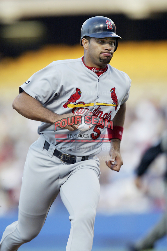 Albert Pujols of the St. Louis Cardinals runs the bases during a 2002 MLB season game against the Los Angeles Dodgers at Dodger Stadium, in Los Angeles, California. (Larry Goren/Four Seam Images)