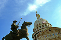 "State Capitol building and statue honoring the 8th Texas Cavalry, Provisional Army of the Confederate States, also known as ""Terry's Texas Rangers"". Austin Texas."